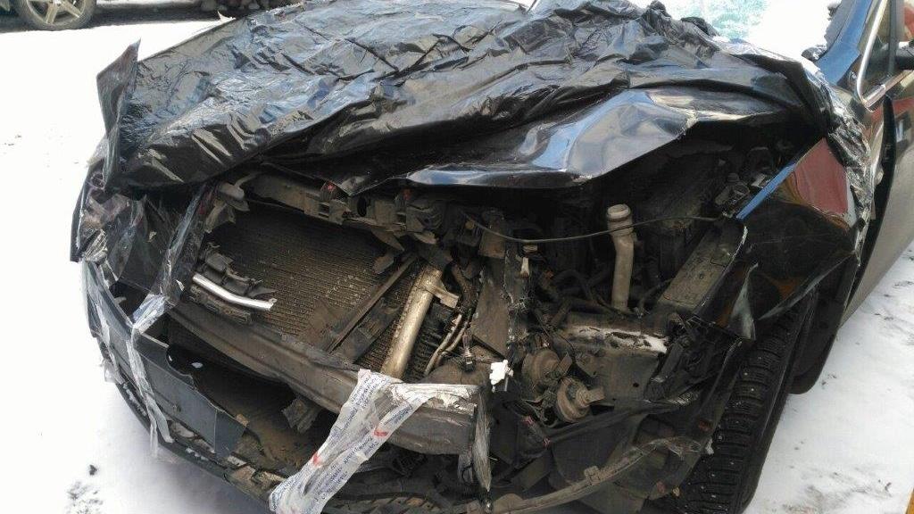 Повреждения кузова Opel Astra после лобового удара